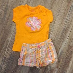 Matching set. Short sleeves and shorts.